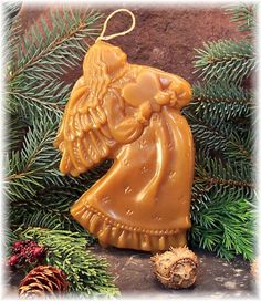 I love Beeswax ornaments. My grandmother had a few from her childhood like this angel, they smelled so wonderful. Wish I knew how to make them!