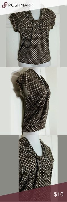"""New York & Co Geometric Blouse Brown & black cap sleeve, stretchy blouse. Bust: 35""""; Length in the back from the shoulder:  24 1/2"""". 95% Polyester, 5% Spandex. Machine washable. Smoke free home. Thanks for shopping my closet 🌺! New York & Company Tops Blouses"""