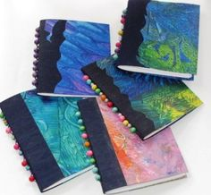 small books using a selection of paste papers for the covers