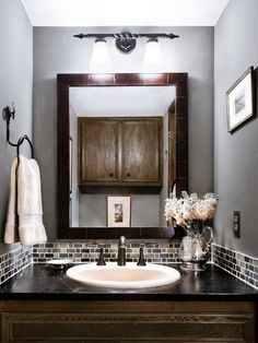 "Mix brown with gray to keep the bathroom feeling ""warm"".-small tile back splash. *powder room!!*"