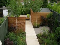 small contemporany garden by olivebay. really like this, espceilly the screening of the shed, pathway and seating area