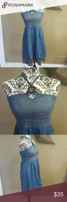 """Denim Embroidery Halter Dress This dress is adorable! It is a denim colored but soft cotton type material. Embroidery on the bust and bottom hem. Smocked back does allow for some stretch in the bust and waist. Side zipper. Padded cups. Braided ties around the neck with wooden o'ring and beads on the ties.   💘Measurements (laying flat, unstretched): Bust-16"""" Waist-15"""" Length-#33"""" Lucy & Co. Dresses Midi"""