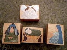 block nativity with fabric/paper scraps.