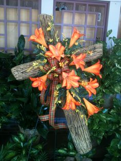 Fall Cross with Orange Lilies and Yellow filler