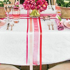 Easter Ribbon Table Runner | To re-create this look, start with six rolls of ribbon. Measure the length and width of your tablecloth to determine the ribbon lengths. (Add a few inches just in case.)