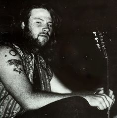 Another very old photo that shows the original tattoos. I believe they have been covered over. He does have his arms tattooed all over. Not just the hands.  This is from the cover of the Beat Happening/Screaming Trees EP. I'm really annoyed that someone edited the other person out of the photo! He's about 23 here, btw.