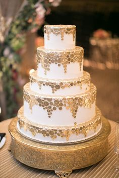 Gold and white five-tiered wedding cake