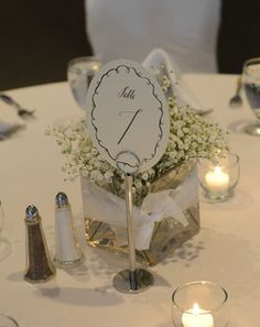 Mrs. Powder Puff's baby's breath centerpieces and DIY table numbers.