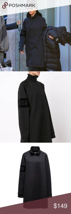 """Fenty x Puma by Rihanna Oversized Sweater Nwt THE FENTY PUMA  BY RIHANNA  OVERSIZED NECK ZIP PULLOVER   AUTHENTICITY GUARANTEED  NEW WITH TAGS COLOR ~ BLACK  An elongated voluminous sweatshirt made of warm, fuzzy fleece.  Its high collar features Rihanna's signature piercing zipper puller and """"Autumn Winter 2016 Collection"""" is stamped at the back, making this a collectible item  Wear it as a top or a dress Rihanna Puma Sweaters Cowl & Turtlenecks"""