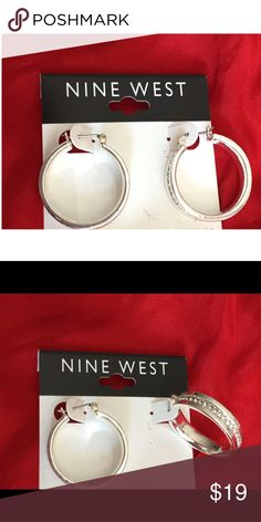 Nine West NWT beautiful sparkling silver hoops. Nine West, stunning silver nickel-free, lever-back hoops, NWT. About the width of a quarter, very beautiful Nine West Jewelry Earrings