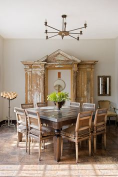 The dining room features a collection of vintage pieces. How about making the OBJECT like a replica of old wall panels ( not sure what to call it). But definitely stunning sculptural . or frame a window