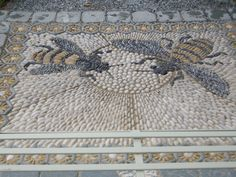 Beautiful 'Bees' pebble mosaic.
