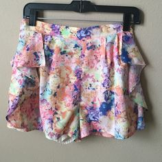 Skies are blue ruffle side shorts size small Pretty watercolor print shorts.  Features elastic waist, side pockets and ruffles on the side. Size small Skies are blue Shorts