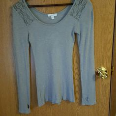 Long sleeved shirt for ladies Very cute long sleeved shirt. It has a see through lace at the shoulders which I pictured. Also has thumb holes at the end of the sleeves. Worn but in excellent condition. Tops Tees - Long Sleeve