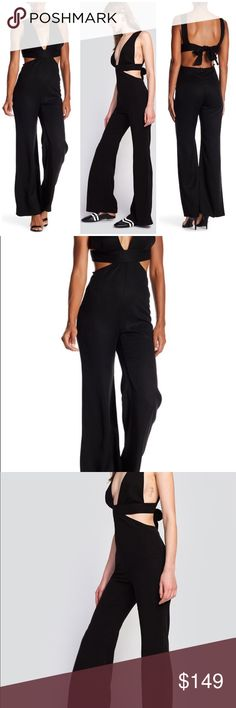 Wildfox Salty Blonde Jumpsuit A strategically cutout jumpsuit shows off a little bit of skin for a sultry, seductive look.  - V-neck  - Sleeveless  - Back hidden zip, self-tie, and hook-and-eye clasp closure  - Solid color  - Made in USA  Fiber Content 100% Lyocell  Care Dry clean only  Fit: this style fits true to size.  Brand new with tag. Retail price $198.  Smoke free and pet free. Wildfox Pants Jumpsuits & Rompers