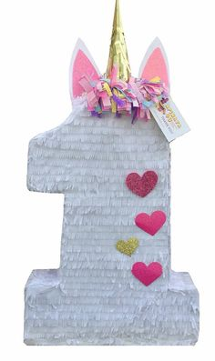 Handcrafted pinata made from recycled cardboard Available as a traditional whack pinata Approx. Size (with horn) is 24 Tall 16 wide 4 Deep Size of Number One is 20 Tall Holds approx. 4-6 pounds of candy, confetti or other goodies (not included) Easy access opening on top to fill