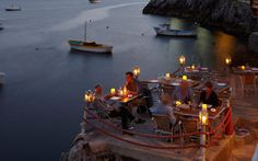 Restaurants with a View:  Il Pirata, Praiano, Italy Antonio Sersale, owner of Positano's Le Sirenuse hotel, swears by the sea-urchin linguine at this Amalfi Coast idyll, where a sun-drenched terrace is built into rocks above a glittering cove. Via Terramare; ristoranteilpirata.net. $$$