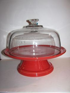 Scarlet Fiesta® Dinnerware Covered Cake Stand ~ This cake stand is made from a Hostess Bowl turned upside down and a 12 inch Pizza Tray placed on top. There is also a Glass Dome covering it | WorthPoint