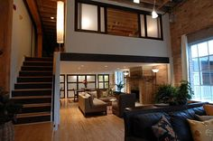 loft windows | Stunning loft apartment with beautiful window treatments for the ...