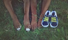 Pregnancy detail photo with baby shoes baby accessories. Maternity photos with…