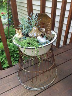 Fairy garden in enamel basin sitting on vintage metal egg basket. Yard Landscaping, Backyard Patio, Backyard Ideas, Garden Ideas, Front Yards, Front Porch, Wire Egg Basket, Outdoor Fun, Outdoor Decor