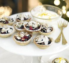 Stirring zingy cranberries into bought mincemeat and making your own simple almond pastry really brings these mince pies to life