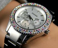 Ninety-two multicolored stones encircle the silver-tone dial of this stainless steel Stella