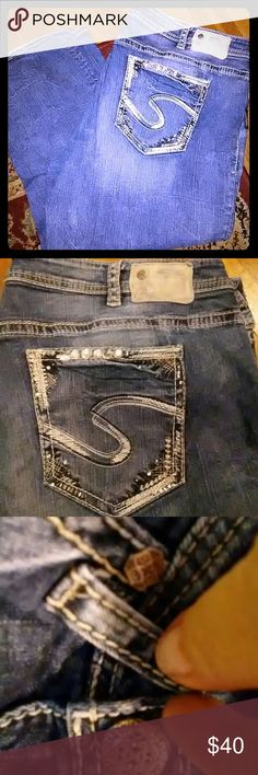 Silver brand (Western Glove Works) suki capri Silver brand suki super stretch capri's. Embroidered and blinged out pockets. Wiskered, faded and has jewelry style button and rivets. Worn twice. Plus size 22. PRICE IS FIRM NO TRADES OR PAY PAL Silver Jeans Jeans Straight Leg