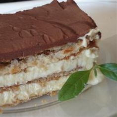 Chocolate Eclair Cake Recipe Desserts with vanilla instant pudding, milk, frozen whipped topping, chocolate graham crackers, milk, unsweetened cocoa powder, white sugar, butter, vanilla extract