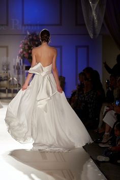 -SposiEventi  Plunging low back. Weightless wedding dress with big bow on the back. Skirt and train in silk chiffon - Discover more on http://www.giuseppepapini.com/