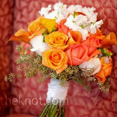 Kat's bouquet was made up of orange calla lilies, orange roses, and white stalk.