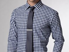 You could invert the look for the groomsmen -- gingham shirt + navy or gold tie -- so your groom stands out?