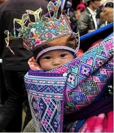 Expression of Love through Baby Carrier    Embroidery was a symbol of femininity and feminine accomplishment in Hmong Miao ethnic tribes. Every stitch and thread of a mother's embroidery work on children's hats, bibs, shoes, clothes, and baby carriers is the deepest expression of a mother's affectionate embrace to her child.