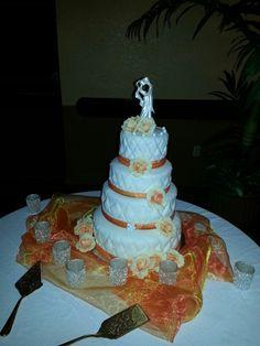4 tier diamond cut orange and white wedding cake