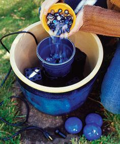 Advertisement: How To Build A Mini Water Garden Oasis Written By: Diana Smith We all love the soothing sound of Homemade Water Fountains, Diy Water Fountain, Water Pond, Garden Water, Outdoor Water Features, Water Features In The Garden, Garden Crafts, Garden Projects, Small Water Gardens