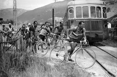1937: Roger Lapebie (right) jumps off his bike to cross rail tracks during the Tour de France