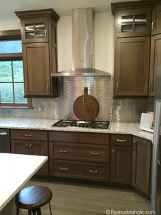 Espresso kitchen love the combination of dark cabinets for Chocolate kitchen cabinets with stainless steel appliances