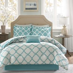 The Madison Park Essentials Concord complete bed and sheet set creates a simple yet chic look in your space. The fretwork pattern creates a modern look with its white design on a dusty teal base.