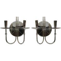 A Pair of Candelabra by T.Parzinger in Silver Plate | From a unique collection of antique and modern wall lights and sconces at http://www.1stdibs.com/furniture/lighting/sconces-wall-lights/