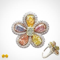 Novel Collection. A rainbow of rare fancy color pear shape diamonds, expertly set in an eye catching flower motif design.