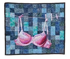 Wall hanging quilt of a bra, made for breast cancer awareness, by Luke Haynes