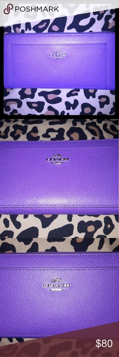 Coach Wallet (Limited Edition) Pre-Owned/Excellent Condition Limited Edition Woman's Coach Wallet Hard to Find Royal Collection in Regal Purple   (Used a few times only because it was given as a gift, but I have one in a lighter shade of violet that I prefer from the same collection!)  Features; 12 Credit Card Slots 2 End Compartments  3 middle section installments Zippered center change pocket Front Pocket Under Logo Coach Bags Wallets