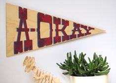 "How to: Make a DIY Wooden Pennant - i'm picturing these with like ""north van"" or something on them?"