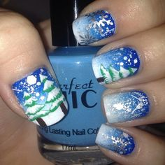 Beautiful winter nail art by @ellagoder using snowflake and tree stickers from Whats Up Nails whatsupnails.com (link in bio)