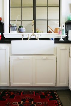 We are still chipping away at improvements to our kitchen area. The faux soapstone black concrete...