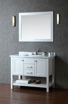 """$1299.00  Vanity Dimensions: 42""""L x 22""""W x 34.6""""H  Matching wood-framed 39.4""""W x 31.5""""H mirror included  Two doors with soft-closing hinges  Two drawers with soft-closing sliders  White carrera marble countertop (1"""" edge) w/matching backsplash design.  All marble tops are finished by hand, pre-drilled for all 8"""" widespread faucets, and double-sealed for scratch-resistance and long-term durability  cUPC-certified rectangular undermount sink  Color: White Cloud Grey  Faucet Sold SeparatelY"""