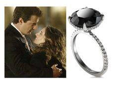 Carrie\'s Black Diamond Ring. This 5 karat black diamond is set in 18 karat  white gold with 80 pave diamonds by designer Itay Malkin.