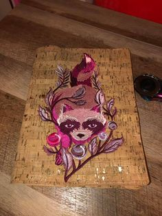 Robin made this great cork notebook cover with a stunning Tula Pink racoon embroidered design from Urban Threads. I have a FREE tutorial to make a cork notebook cover on my facebook page and You Tube channel. Embroidery Online, Embroidery Designs, Urban Threads, Racoon, Cork, Robin, Sewing Patterns, Tube, Channel
