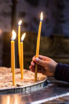 Lighting a candle at the Holy Monastery of Saint Nicholas of Anapafsas in Meteora, Greece.  #greece #meteora #candles #monastery #europe