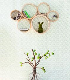 use bamboo steamers as a frame, diy~cute kid stuff display for up high. Seems too delicate for little hands.